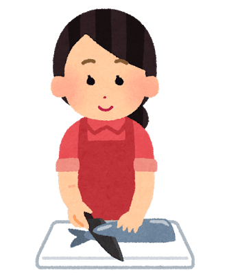 魚を調理する女性